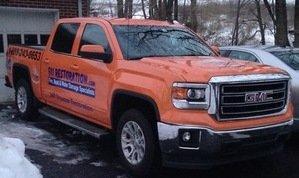 Disaster Restoration Truck At Winter Flooding Site