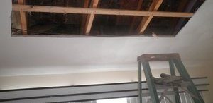 Water Damage Ceiling Restoration In Progress
