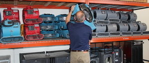Water Damage East Garden City Restoration Technician Prepping Air Movers