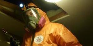 Fire Damage Restoration Technician In Full Gear