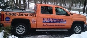 Fire Damage Restoration Truck On Driveway In Winter