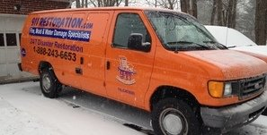 Snow Storm Damage Restoration Van At Residential Job Site